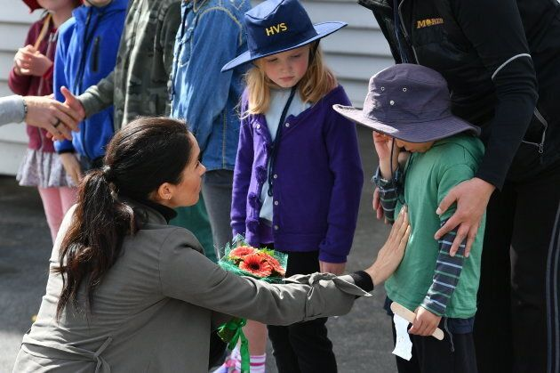 The Duchess of Sussex speaks to an emotional Joe Young, 5, in Wellington, New