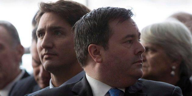 JasonKenneylooks around as he sits next to JustinTrudeauduring an event in Ottawa on Jan. 27, 2015 in Ottawa.
