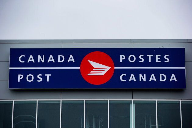 The Canada Post logo is seen on the outside the company's Pacific Processing Centre, in Richmond, B.C.,...