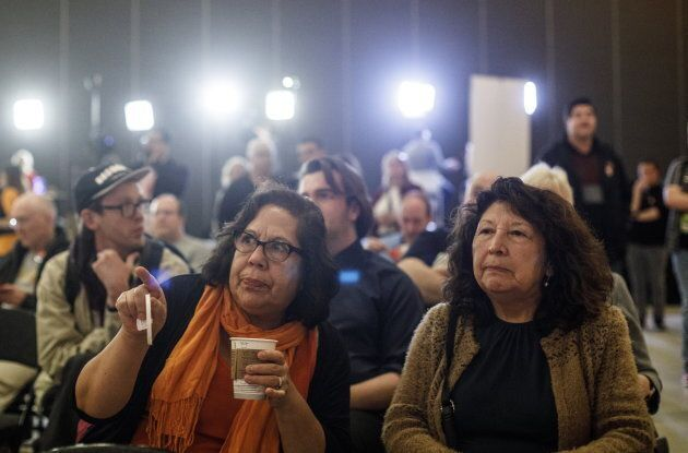 NDP supporters watch as the polling numbers come in, in Edmonton on Tuesday, April 16,