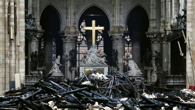This photo taken on April 16, 2019, shows the altar surrounded by charred debris inside the Notre Dame...