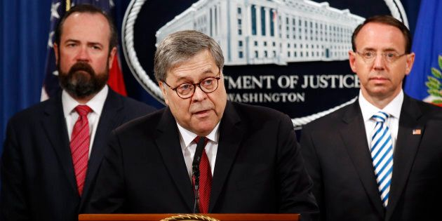 U.S. Attorney General William Barr speaks alongside Deputy Attorney General Rod Rosenstein, right, and...
