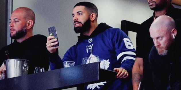 Drake appears to be realizing he's cursed while he attends a playoff game between Toronto Maple Leafs...