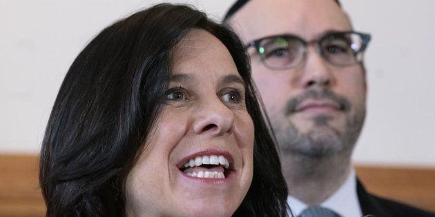 Montreal mayor Valerie Plante responds to a question as opposition leader Lionel Perez looks on during...