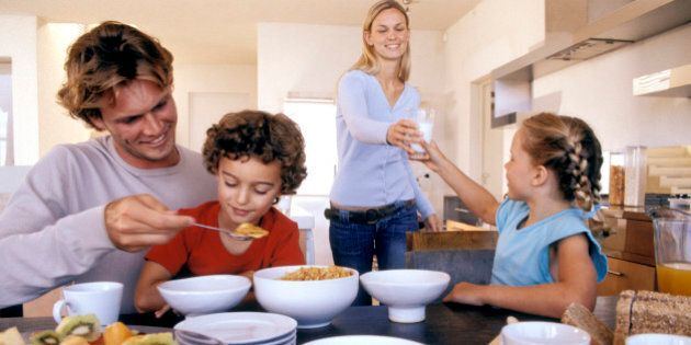 Family eating breakfast in the kitchen