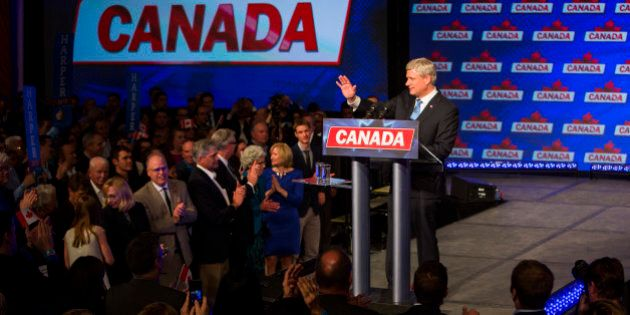 Conservative Leader Stephen Harper, Canada's prime minister, waves as he attends a news conference where...