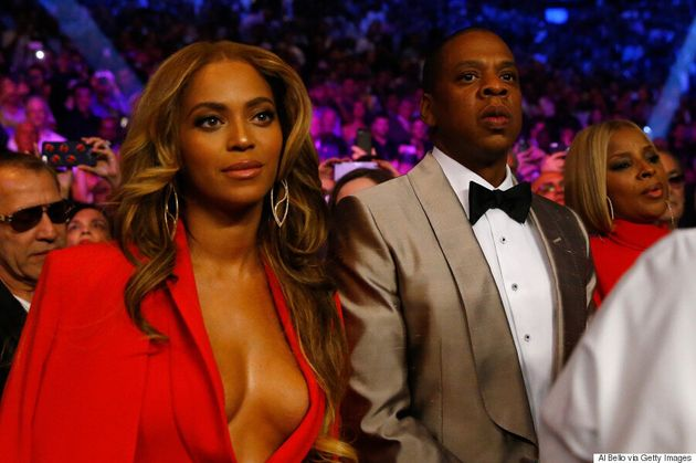 Beyonce Wears Red-Hot Pantsuit To Mayweather-Pacquiao