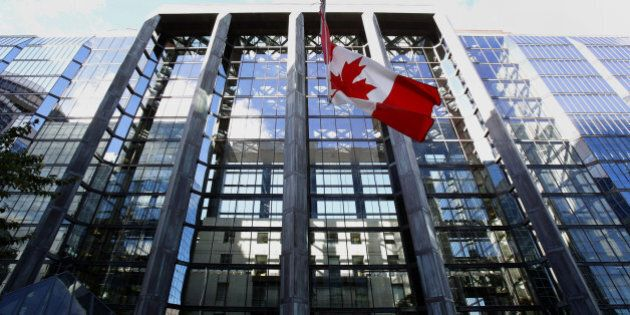 The Canadian flag flies outside the Bank of Canada building in Ottawa, Ontario, Canada, on Wednesday,...