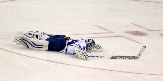 Toronto Maple Leafs goalie James Reimer lies on the ice after New Jersey Devils right wing Jaromir Jagr, of the Czech Republic, scored during the third period of an NHL hockey game, Friday, Feb. 6, 2015, in Newark, N.J. The Devils won 4-1. (AP Photo/Julio Cortez)