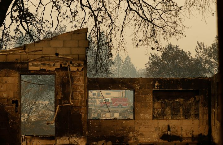 A firetruck drives through an area burned from the wildfire in Paradise, Calif., last November.