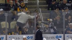 Hockey Fan Smiles As He Steals Little Kid's