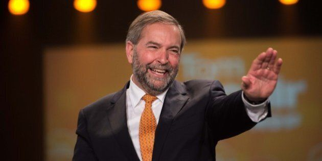 Canadian New Democratic Party (NDP) leader Tom Mulcair acknowledges applause at a rally in Montreal on...