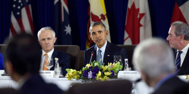 President Barack Obama, center, sitting next to Australia's Prime Minister Malcolm Turnbull, left, and U.S. Trade Representative Michael Froman, right, speaks during a meeting with other leaders of the Trans-Pacific Partnership countries in Manila, Philippines, Wednesday, Nov. 18, 2015, ahead of the start of the Asia-Pacific Economic Cooperation (APEC) summit. (AP Photo/Susan Walsh)
