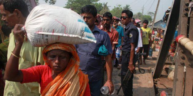 Bangladeshi Hindu devotes walk across a bridge to participate in a Hindu bathing ritual in Langalbandh,...