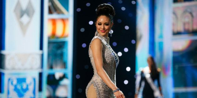 Miss Canada Riza Santos presents herself during the preliminary competition of the 2013 Miss Universe pageant in Moscow, Russia, on Tuesday, Nov. 5, 2013. Beauties will compete for the title of Miss Universe in Moscow on Nov. 9. (AP Photo/Pavel Golovkin)