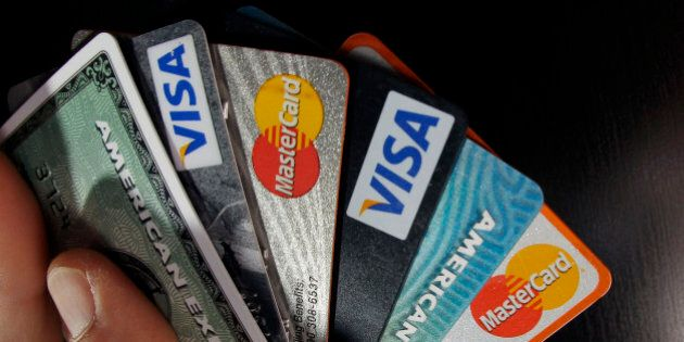 FILE - In this March 5, 2012 file photo, consumer credit cards are posed in North Andover, Mass. The...