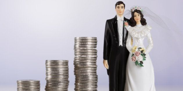 Wedding couple and coin rolls.