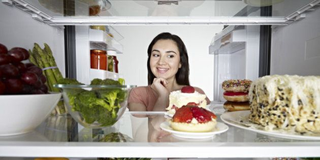 Woman looking at cake in through the
