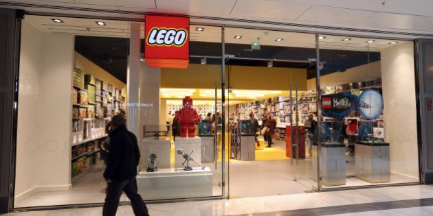 A man passes by the newly-opened store of Danish construction toys group Lego on October 18, 2012 at...