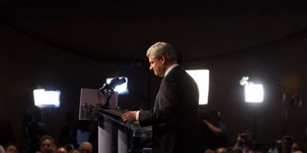 Conservative Leader Stephen Harper, Canada's prime minister, attends a news conference where he conceded...