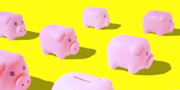 Pink piggy banks on yellow background (Digital