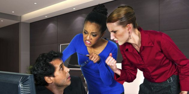 businesswomen taking out anger on guy at the