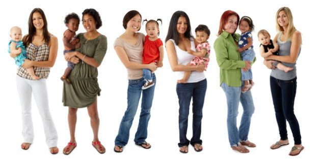 Six multi-ethnic mothers standing in a line while holding their babies. Mothers in order: Ecuadorian/White, Chinese/African American, Korean, Indian, Hispanic, White