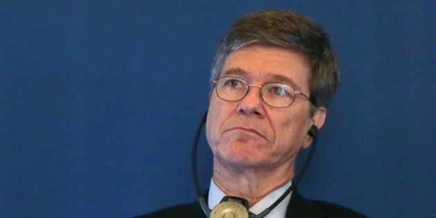 US Economist Jeffrey Sachs listens to a speech by the French Foreign Affairs Minister after he received...