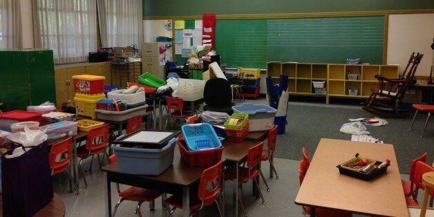 A teacher sets up an elementary school classroom in Surrey, B.C. in