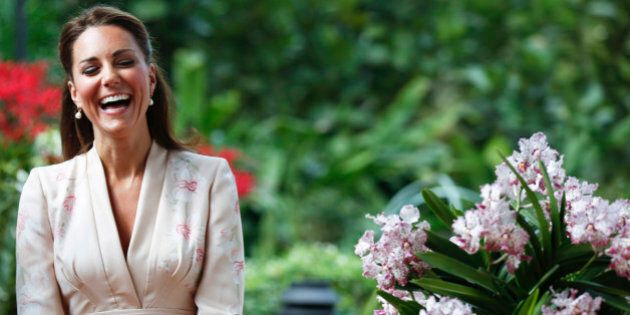 Kate, Duchess of Cambridge, smiles during a ceremony naming a hybrid orchid in their honor at the Orchid...