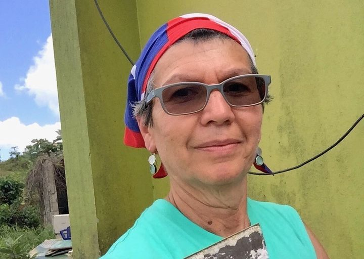 Edna Benitez, rebuilding a home in Miraflores.