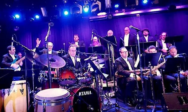 Bobby Sanabria, on drums, and his Multiverse Big Band playing a benefit concert for Puerto Rico musicians,...