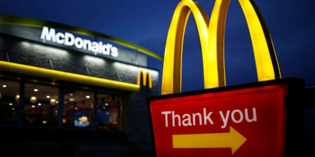 Golden arches mark the entrance to a McDonald's Corp. restaurant in Shelbyville, Kentucky, U.S., at dawn...