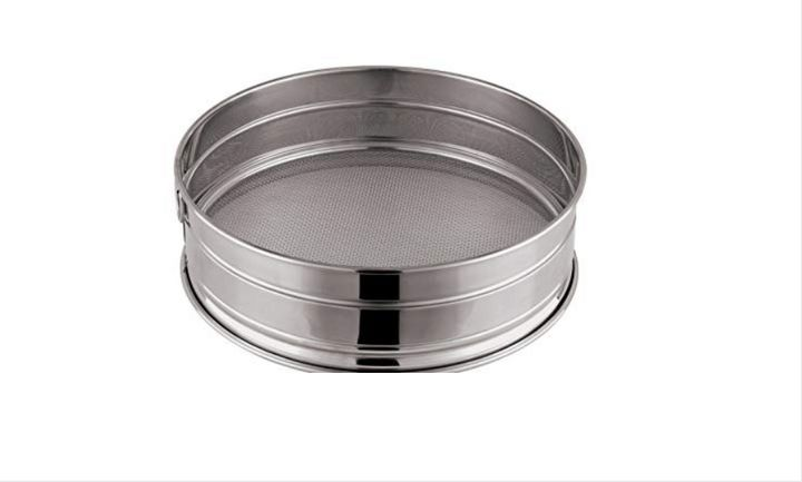 "Candace Nelson uses this <a href=""https://www.amazon.com/Winco-SIV-10-Sieves-10-Inch/dp/B0037XH6MM"" target=""_blank"" rel=""noopener noreferrer"">drum sieve</a> to sift powdered sugar."