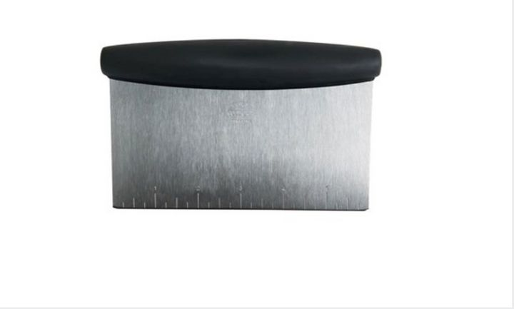 "Kelly Fields uses a bench scraper like <a href=""https://www.amazon.com/OXO-Multi-purpose-Stainless-Scraper-Chopper/dp/B00004OCNJ"" target=""_blank"" rel=""noopener noreferrer"">this one from OXO</a>."
