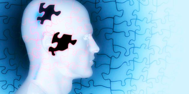 Concept of memory loss as a puzzle with missing pieces.