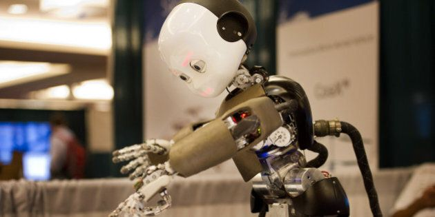 The iCub robot, made at the Istituto Italiano Di Tecnologia in Genova, Italy, identifies items during...