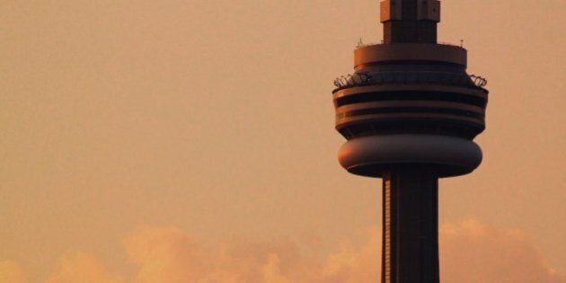 Toronto's CN Tower as seen from Centre Island during sunset.