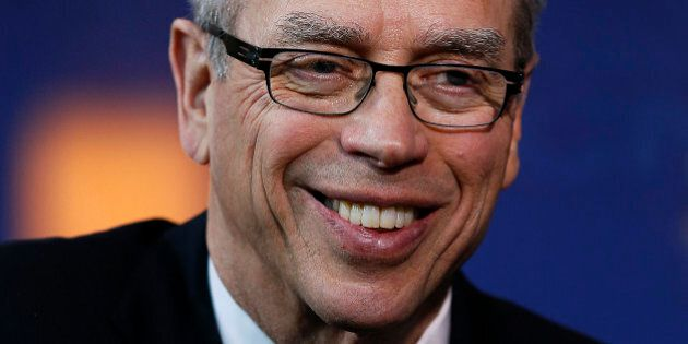 Joe Oliver, Canada's natural resources minister, smiles following an interview during the 2014 IHS CERAWeek...