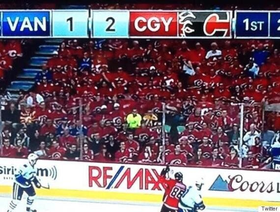Guy In Yellow Upstages Calgary Flames, Vancouver Canucks Playoff