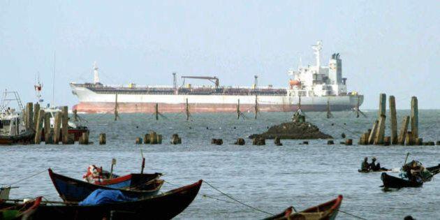 VUNG TAU, VIET NAM: A oil tanker ship sails past a fishing port in Southern coastal city of Vung Tau,...