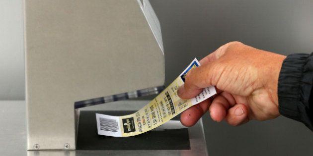 MELBOURNE, AUSTRALIA - JANUARY 19: A tennis fan scans his ticket as he arrives at Melbourne Park during...