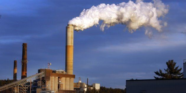 FILE - In this Tuesday, Jan. 20, 2015, file photo a plume of steam billows from the coal-fired Merrimack...
