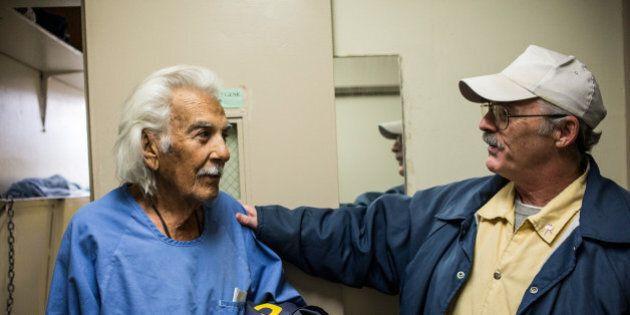 SAN LUIS OBISPO, CA - DECEMBER 19: (Editorial Use Only) Anthony Alvarez (L), age 82, talks to Phillip...