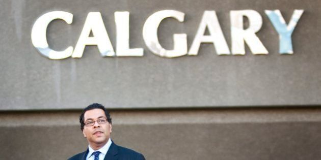 Newly-elected Calgary mayor Naheed Nenshi walks past city hall the day after being elected to the office...