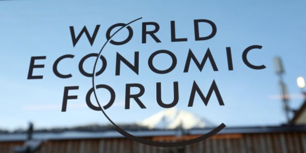 A logo sits on a glass panel inside the Kongress Zentrum, also known as Congress Center, the venue of the World Economic Forum (WEF) in Davos, Switzerland, on Monday, Jan. 19, 2015. This week World leaders, influential executives, bankers and policy makers will attend the 45th annual meeting of the World Economic Forum in Davos that runs from Jan. 21-24. Photographer: Chris Ratcliffe/Bloomberg via Getty Images