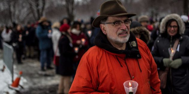 MONTREAL, CANADA - DECEMBER 6: Canadian people light candle as they take part in a ceremony at Notre-Dame de Neiges cemetery to mark the 25th anniversary of the Ecole Polytechnique massacre in Montreal, Canada on December 6, 2014. 25 years to the day, 25-year-old Marc Lepine killed 14 women at the École Polytechnique because of their gender. (Photo by Amru Salahuddien/Anadolu Agency/Getty Images)