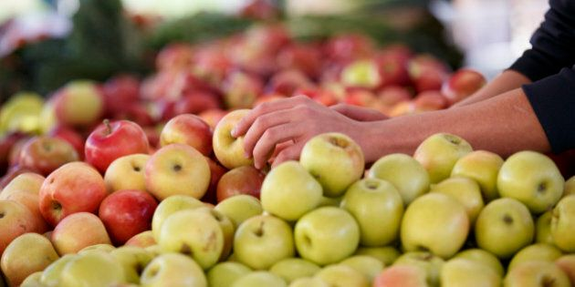 Apples and other healthful choices are on display at a Sunday morning farmers market in Arlington, Va.,...
