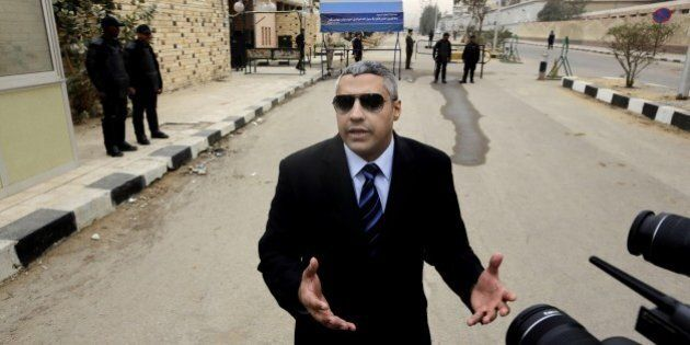 Canadian Al-Jazeera English journalist Mohamed Fahmy, speaks to the media outside a court before his...