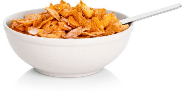 Bowl of corn flakes cereal, on white background, cut out